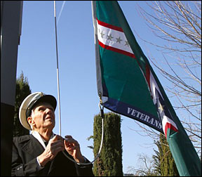 Jim Parks raises the Veterans Remembered Flag.