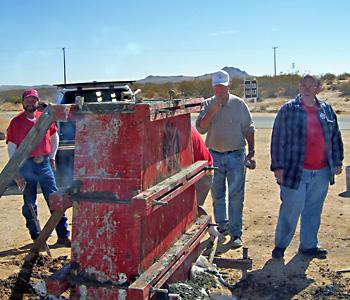 Supervising the pour -- PXL's Don Johnson, Joe Szot and Steve Born.