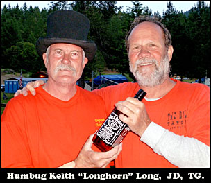 Humbug Keith 'Longhorn' Long is presented with JD by TG for PXL.